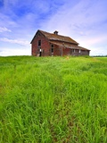 Abandoned red barn sitting on the top of a hill on a pioneer homestead in rural Alberta Canada Photographic Print by Robert McGouey