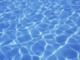 Speckled Water Pattern in Resort Swimmimg Pool Photographic Print by Chris Cheadle