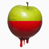 Apple dripping with color Photographic Print by Mike Kemp