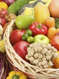 Stack of different kinds of fruits and vegetables in a basket Photographic Print