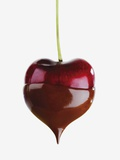 Heart cherry dipped in chocolate sauce Lámina fotográfica