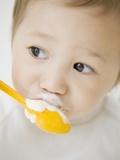 Boy having ice cream with spoon Photographic Print