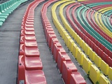 Rows of Colorful Seats in Empty Stadium Photographic Print by Paul Gun