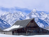 Moulton Barn below the Teton Range in winter Photographic Print by Scott T. Smith