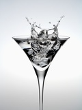Wineglass of splashing water Photographic Print