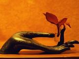 Sculpted Hand Holding Massage Oil Vial Reprodukcja zdjęcia autor Dave Bartruff