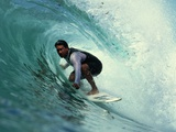 Professional Surfer Riding a Wave Photographic Print by Rick Doyle