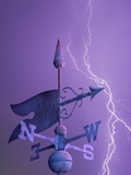 Weathervane and Lightning Bolt Photographic Print by L. Clarke