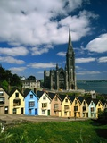 St. Coleman's Cathedral of Cobh Behind Colorful Row Houses Photographic Print by Charles O'Rear