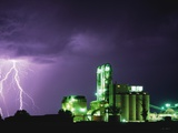Lightning Striking near Factory in Texas Photographic Print by Paul Souders