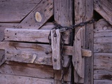 Chains and Lock on Weathered Barn Door Photographic Print by Mick Roessler