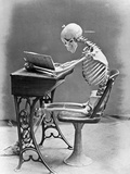 Skeleton Reading at Desk Fotografisk tryk af Bettmann