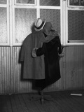 Hanging Coats Posed as an Embracing Couple Photographic Print by  Bettmann