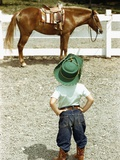 Young Cowboy Looking at Horse Photographic Print by William Gottlieb