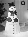 Dapper Snowman Outside a House Photographic Print by  Bettmann