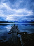 Pier at Lake McDonald Under Clouds Photographic Print by Aaron Horowitz