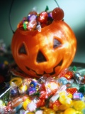 Halloween Candy in Jack O'Lantern Pail Photographic Print by Danilo Calilung