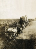 Covered Wagons on the Plains Going West Photographie par Bettmann