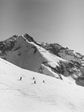 Skiers Skiing Down Mountain Photographic Print by Cathrine Wessel