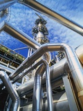Pipes Overhead at Oil Refinery Photographic Print by Kevin Burke