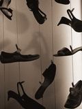 Ladies Shoes Hanging on Wire Photographic Print by Henry Horenstein
