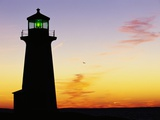 Peggy's Cove Lighthouse at Sunset Photographic Print by Paul Souders