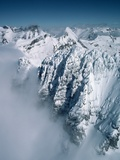 Snow-Covered Rugged Mountain Ridges Photographic Print by Lowell Georgia