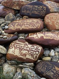 Buddhist Prayers on Carved Mani Stones in Tibet Photographic Print by Craig Lovell