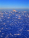 The Snowy Peak of Mount Rainier Rises Above the Clouds Photographic Print by Ross