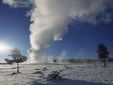 Old Faithful Geyser Erupting in Winter Photographic Print by W. Perry Conway