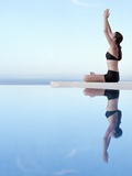 Woman Exercising on Swimming Pool Edge Photographic Print by Jutta Klee