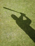 Shadow of Baseball Player Swinging Bat Photographic Print by Randy Faris