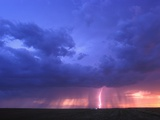 Lightning at Sunset Photographic Print by Jim Reed