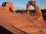 Delicate Arch in Low-Lying Sunlight Photographic Print by Joe McDonald