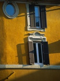 Shuttered Windows on Yellow Building Photographic Print by Bill Ross
