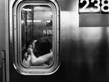 Passionate Couple Kissing in a Subway Car Photographie par Matthew Alan