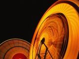 Spinning Ferris Wheels at Night Photographic Print by Hisham Ibrahim