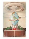 Receptionist in Front of Elongated Globe Prints