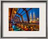 The Sky Bar in Kuala Lumpur with a view of Petronas Framed Photographic Print by Trey Ratcliff