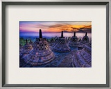 The sunrise as the caged Buddhas look on Framed Photographic Print by Trey Ratcliff