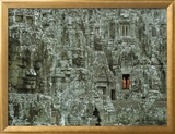 Buddhist Monks in a Doorway of the Ruins of the Bayon at Angkor Framed Photographic Print by W. E. Garrett