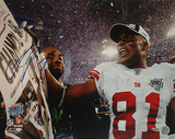 Amani Toomer SB XLII Celebration with Newspaper Photo