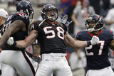 Houston Texans and Cincinnati Bengals: Brooks Reed, Quintin Demps Bilder av Tony Gutierrez