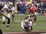 San Francisco 49ers and New Orleans Saints: Vernon Davis and Roman Harper Photographic Print by Paul Sakuma
