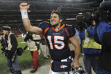 Denver Broncos and Pittsburgh Steelers: Tim Tebow Photographic Print by Chris Schneider