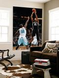 San Antonio Spurs v New Orleans Hornets: Tim Duncan and Emeka Okafor Print by Chris Graythen