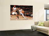 San Antonio Spurs v Los Angeles Clippers: Eric Bledsoe and George Hill Prints by Andrew Bernstein