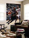 Detroit Pistons v Minnesota Timberwolves: Corey Brewer and Tracy McGrady Posters by David Sherman