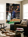 Denver Nuggets v Boston Celtics: Nene and Shaquille O'Neal Posters by Brian Babineau