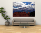 The Sun Breaks Through the Clouds to Highlight the Summit of Pikes Peak Poster